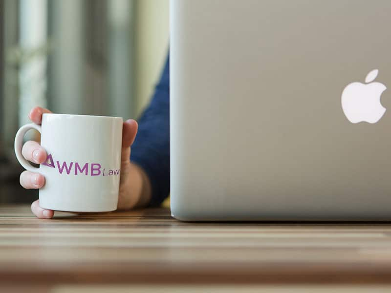 WMB Law logo on a mug